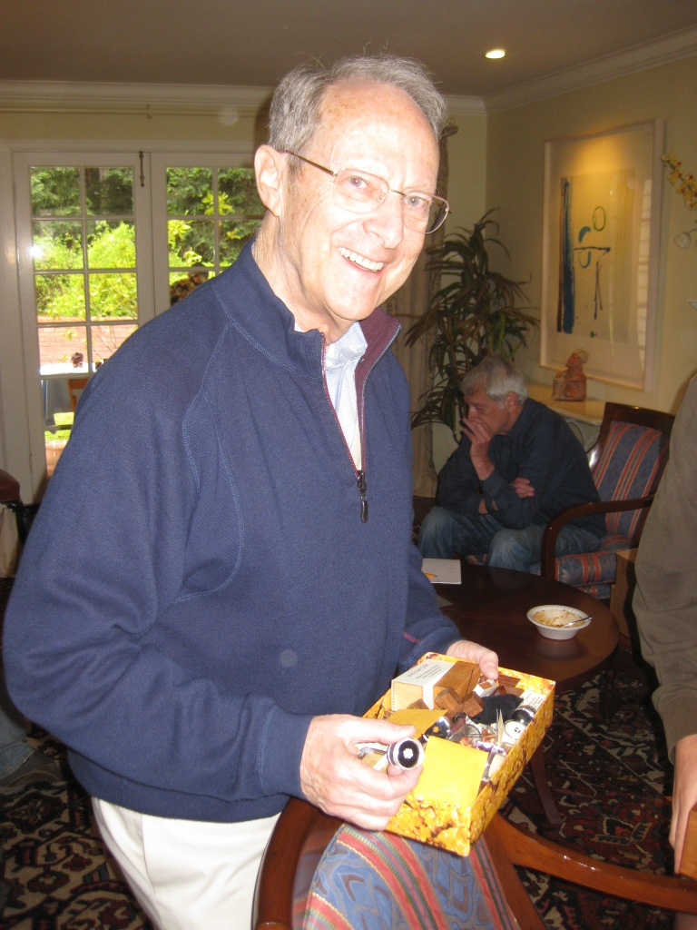Alan Boardman with a cigar box containing one of every puzzle he makes