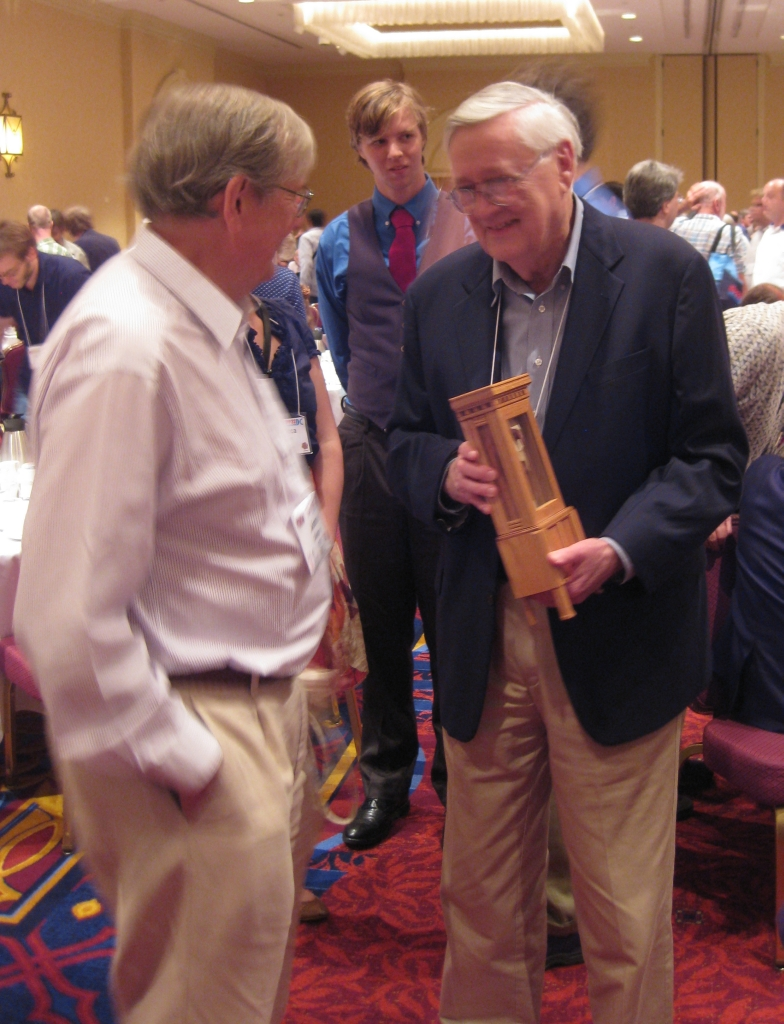 Jerry Slocum with the Grandfather clock talking to James Dalgety