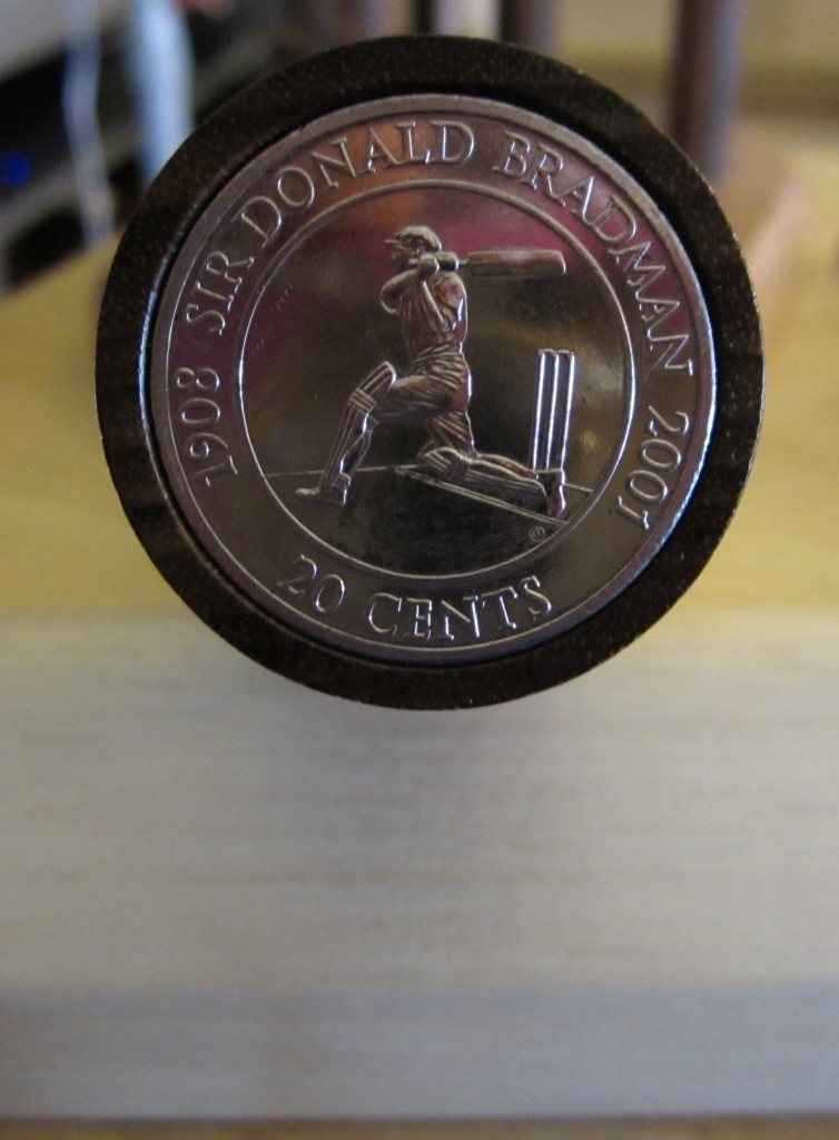 Sir Donald Bradman coin crowns the handle