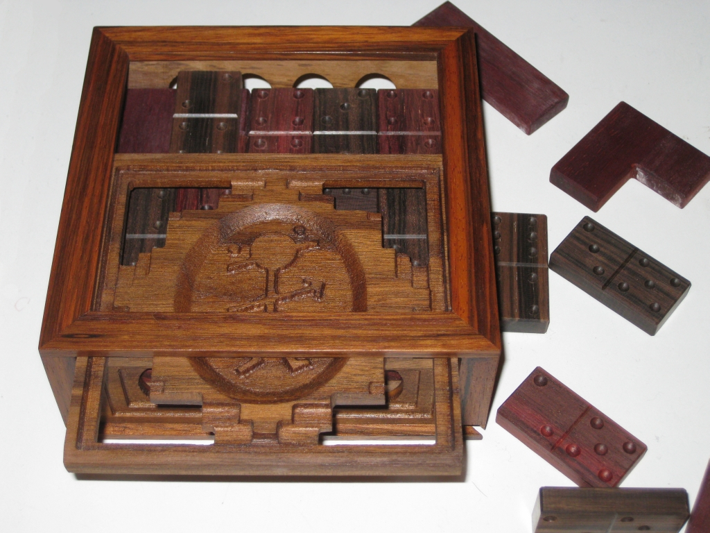 The opened box, allowing access to the dominoes